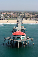 9 September 2009:  John Kissel memorial gathering northside at the Huntington Beach Pier. Over 150 surfers and friends gathered for a traditional surfers memorial service by paddling out on their boards and honoring their friend in the pacific ocean. Aerial photo from helicopter. Overview of the pier, beach and surf.