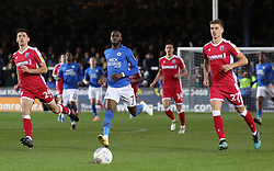 Mohamed Eisa of Peterborough United chases a lose ball with Thomas O'Connor and Jack Tucker of Gillingham - Mandatory by-line: Joe Dent/JMP - 11/01/2020 - FOOTBALL - Weston Homes Stadium - Peterborough, England - Peterborough United v Gillingham - Sky Bet League One