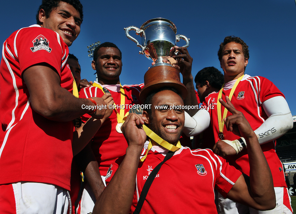 Poverty Bay team mates with the Lochore Cup on Ratu Vosaki's head after winning the Heartland Championship Lochore Cup Final between, South Canterbury v Poverty Bay at Alpine Energy Stadium, Timaru, South Canterbury. Saturday 8 October 2011. Photo : Joseph Johnson/photosport.co.nz