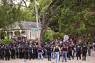The Baton Rogue police stand in a formation in Baton Rouge on Sunday, July 10, 2016.  6 days following the Alton Sterling shooting, the police areseted Aproximaetly 48 people had been were taken into custody by midnight Sunday,