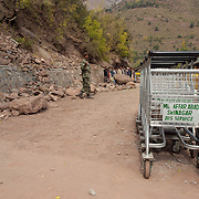 Luggage carts that were once used when the Muzzafarabad - Srinagar bus service was still in service are now being used at the new border opening in Chokoti.  The opening of the border was to reunite families during this time of disaster.
