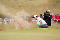 Golf - 2013 Open Championship at Muirfield - Thursday Round One<br /> Rory McIlroy of Northern Ireland struggles in a bunker on the 5th