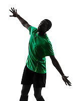 one african man soccer player scoring green jersey in silhouette on white background
