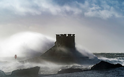 Saltcoats, Scotland, UK. 9 February, 2020.  Storm Ciara at Saltcoats in Ayrshire. With high tide due at midday and winds expected to increase in speed later in the day, the height of the waves are expected to dramatically increase. Pic; Large waves breaking over Saltcoats harbour wall . Iain Masterton/Alamy Live News.