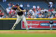 May 19 2011; Phoenix, AZ, USA; Atlanta Braves third basemen Chipper Jones (10) makes the forced out play at first base during the second inning against the Arizona Diamondbacks at Chase Field. The Diamondbacks defeated the Braves 2-1. Mandatory Credit: Jennifer Stewart-US PRESSWIRE..