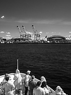 Tour boat and cargo cranes in Seattle harbor black and white