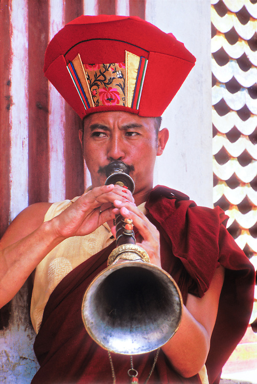 "A Buddhist monk blows a Tibetan-style horn in a ceremony at Swyambhunath (also known as ""The Monkey Temple"") atop a hill overlooking Nepal's Kathmandu Valley. The music the monks played sounded like jazz saxophonist John Coltrane in his last, cosmic, high energy period."