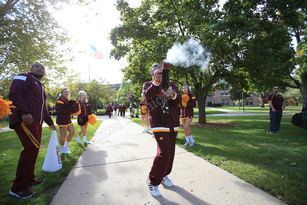 Cheerleaders delivered energetic cheers, free T-shirts rained from cannons and the pep band's instruments blared at popular locations across campus Friday morning as part of Fire Up Friday. Even head football coach John Bonamego joined in on the homecoming festivities, shooting T-shirts to students in Warriner Mall.  Photos by Steve Jessmore/Central Michigan University