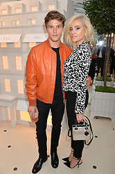 OLIVER CHESHIRE and PIXIE LOTT at a cocktail party to mark the opening of the House of Dior, the United Kingdom's largest and premier Dior boutique at 160-162 New Bond street, London on 8th June 2016.