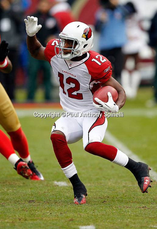 Arizona Cardinals kick returner Andre Roberts (12) returns a kick during the NFL week 17 football game against the San Francisco 49ers on Sunday, January 2, 2011 in San Francisco, California. The 49ers won the game 38-7. (©Paul Anthony Spinelli)