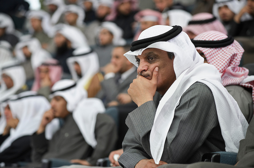 Members of the crowd attending the state opening of parliament's 14th legislative term's first session presided over by HH the Emir Sheikh Sabah Al-Ahmad Al-Sabah Feb 15, 2012 in Kuwait City. Kuwaitis voted Feb. 2 for a new 50-member parliament (National Assembly).