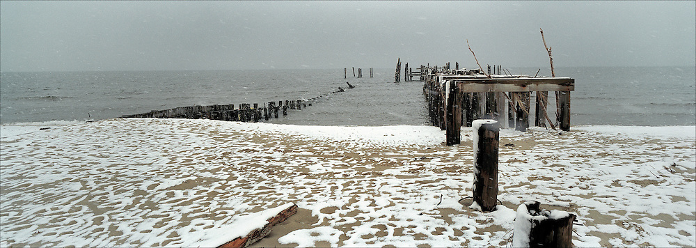 Harrison's Pier, destroyed by Hurricane Isabel in September 2003, is shown covered by snow in January 2004. Photograph by Roger M. Richards