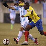 Sergio Aguero, Argentina, is challenged by Walter Ayovi, Ecuador, during the Argentina Vs Ecuador International friendly football match at MetLife Stadium, New Jersey. USA. 31st march 2015. Photo Tim Clayton