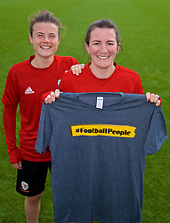 NEWPORT, WALES - Friday, October 5, 2018: Wales' Helen Ward (R) and Hayley Ladd (L) with a Football People T-shirt during a training session at Dragon Park. (Pic by David Rawcliffe/Propaganda)