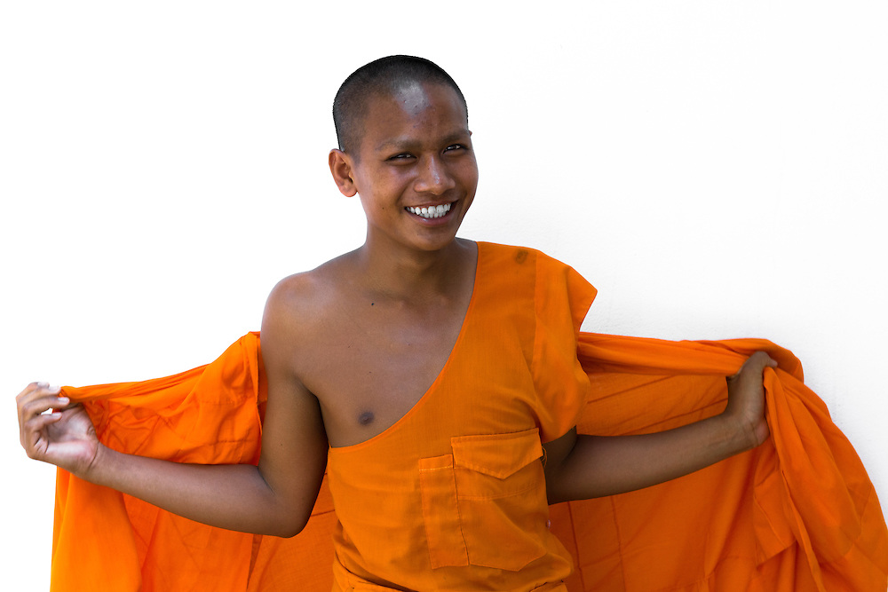 A young buddhist monk named Pong at one of the many monasteries of Luang Prabang (Laos, 2012).<br /> <br /> Licensed by Getty Images (2012).<br /> <br /> Available here: http://www.gettyimages.com/detail/photo/young-buddhist-monk-getting-dressed-royalty-free-image/150239599