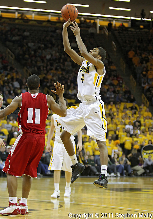February 09 2011: Iowa Hawkeyes guard/forward Roy Devyn Marble (4) puts up a shot over Wisconsin Badgers guard Jordan Taylor (11) during the second half of an NCAA college basketball game at Carver-Hawkeye Arena in Iowa City, Iowa on February 9, 2011. Wisconsin defeated Iowa 62-59.