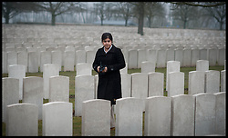 Baroness Sayeeda Warsi looking at the graves of Soldier's at the Lijssenthoek Military Cemetery in Belgium. Sayeeda is visiting the graves of Commonwealth soldiers on the battlefields of France and Belgium as part of the UK Government's programme to commemorate the centenary of the First World War which starts next year, Wednesday  April 10, 2013. Photo By Andrew Parsons / i-Images