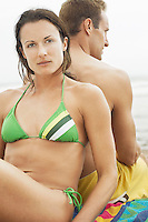 Woman in Bikini Leaning Against Boyfriend's Back