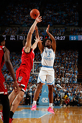 CHAPEL HILL, NC - FEBRUARY 05: Coby White #2 of the North Carolina Tar Heels shoots the ball during a game against the North Carolina State Wolfpack on February 05, 2019 at the Dean Smith Center in Chapel Hill, North Carolina. North Carolina won 113-96. North Carolina wore retro uniforms to honor the 50th anniversary of the 1967-69 team. (Photo by Peyton Williams/UNC/Getty Images) *** Local Caption *** Coby White