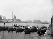 24/06/1959<br /> 06/24/1959<br /> 24 June 1959<br /> Lobster Fishing Boats from Carna, Galway arrive at Ringsend, Dublin. The boats tied together in the harbour with Dublin Gas Company in the background.