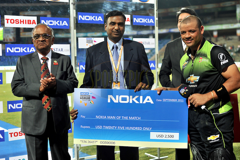 Ashwell Prince of Warriors receives the Power six and Man of the mathc award during match 1 of the NOKIA Champions League T20 ( CLT20 )between the Royal Challengers Bangalore and the Warriors held at the  M.Chinnaswamy Stadium in Bangalore , Karnataka, India on the 23rd September 2011..Photo by Pal Pillai/BCCI/SPORTZPICS