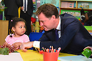 © Licensed to London News Pictures. 02/09/2013. Hammersmith, UK . Talking to Sienna-Leigh. The Deputy Prime Minister, Nick Clegg, gives a speech on making Britain fit for modern families, including free childcare for two-year-olds. The government's two-year-old offer starts in September (15 hours per week of free childcare for those from the 20% most disadvantaged families, based on Free School Meals criteria). The Deputy Prime Minister set out how the offer is being extended from September 2014. . Photo credit : Stephen Simpson/LNP