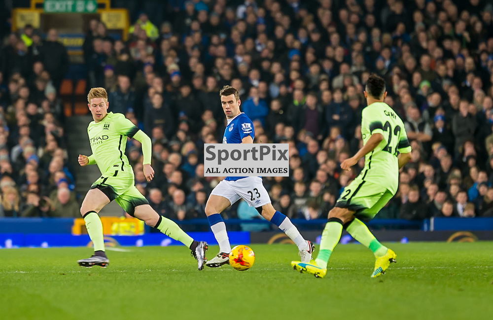 Manchester City defender Gael Clichy passes to Manchester City midfielder Kevin De Bruyne while Everton defender Seamus Coleman gives chase