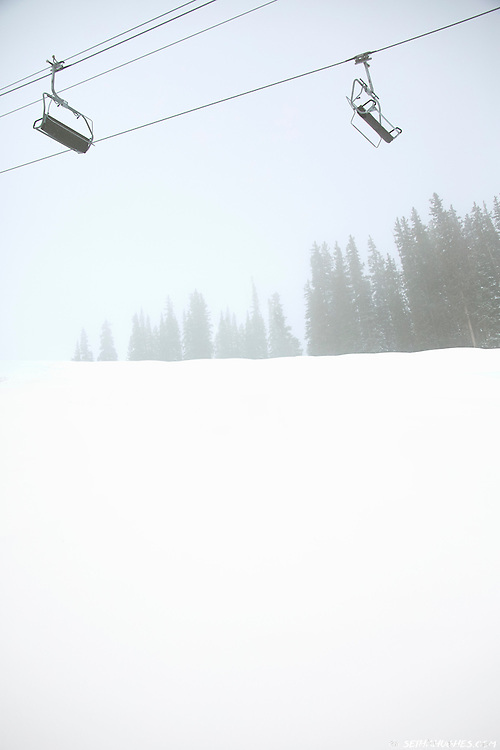 A chairlift on a foggy ski slope in Telluride, Colorado.