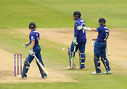 The injured Gloucestershire's Michael Klinger instructs Gloucestershire's Kieran Noema-Barnett and runner Gloucestershire's Chris Dent - Mandatory by-line: Robbie Stephenson/JMP - 07966386802 - 04/08/2015 - SPORT - CRICKET - Bristol,England - County Ground - Gloucestershire v Durham - Royal London One-Day Cup