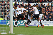 Bolton midfielder Mark Davies falls to the floor as the Derby defenders block his run during the Sky Bet Championship match between Derby County and Bolton Wanderers at the iPro Stadium, Derby, England on 9 April 2016. Photo by Aaron  Lupton.