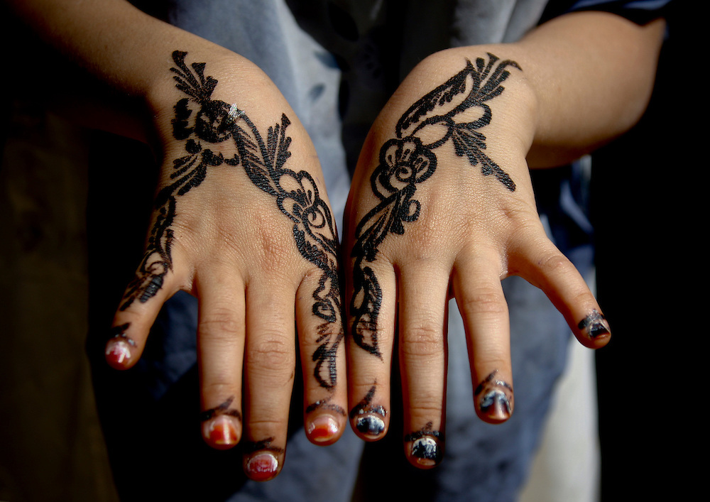 Yemen, Amran, floral designs drawn with henna on a girl's hands. Henna is one of the very few decorations available for women to express their beauty. Most cover their entire body, including their hands.