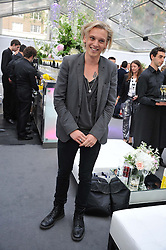 JAMIE CAMPBELL BOWER at the Glamour Women of the Year Awards 2012 in association with Pandora held in Berkeley Square Gardens, London W1 on 29th May 2012.