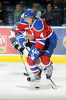 KELOWNA, CANADA, FEBRUARY 15: Keegan Lowe #4 of the Edmonton Oil Kings skates with the puck  at the Kelowna Rockets on February 15, 2012 at Prospera Place in Kelowna, British Columbia, Canada (Photo by Marissa Baecker/Shoot the Breeze) *** Local Caption ***