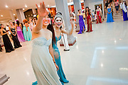 "Oct. 7, 2009 -- BANGKOK, THAILAND:  ""Ladyboys"" wave at spectators and try to entice them into providing tips after a performance at the Mambo Cabaret in Bangkok, Thailand. The performers also sometimes date the male customers of the cabaret. The performers at the Mambo Cabaret in Bangkok, Thailand are all ""Ladyboys,"" or kathoeys in Thai. Recognized as a third gender, between male and female, they are born biologically male but live their lives as women. Many kathoey realize they are third gender in their early teens, some only as old 12 or 13. Kathoeys frequently undergo gender reassignment surgery to become women. Being a kathoey in Thailand does not carry the same negative connotation that being a transgendered person in the West does. A number of prominent Thai entertainers are kathoeys. Photo by Jack Kurtz / ZUMA Press"