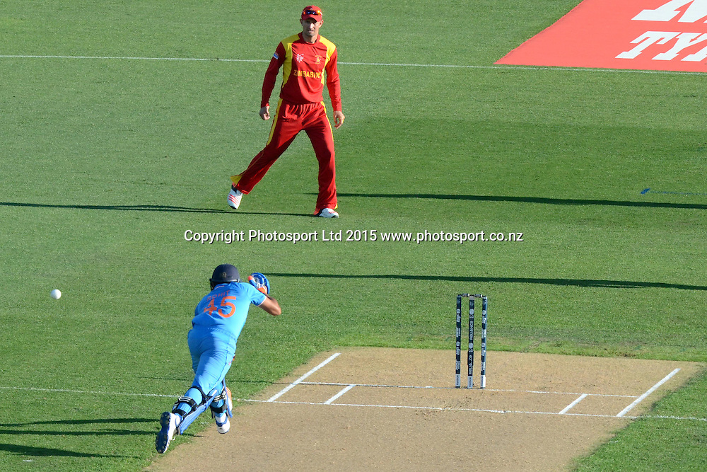Indian batsman Rohit Sharma tries to make his ground to a run-out opportunity during the ICC Cricket World Cup match between India and Zimbabwe at Eden Park in Auckland, New Zealand. Saturday 14 March 2015. Copyright Photo: Raghavan Venugopal / www.photosport.co.nz