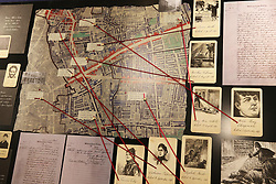 © Licensed to London News Pictures. 04/10/2015. London, UK. Photographs of the victims and a map form part of a recreation of a police station inside the Jack the Ripper Museum.  A planned protest was cancelled at the museum today. Photo credit: Peter Macdiarmid/LNP