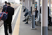 people waiting at a JR train platform near Nara Japan