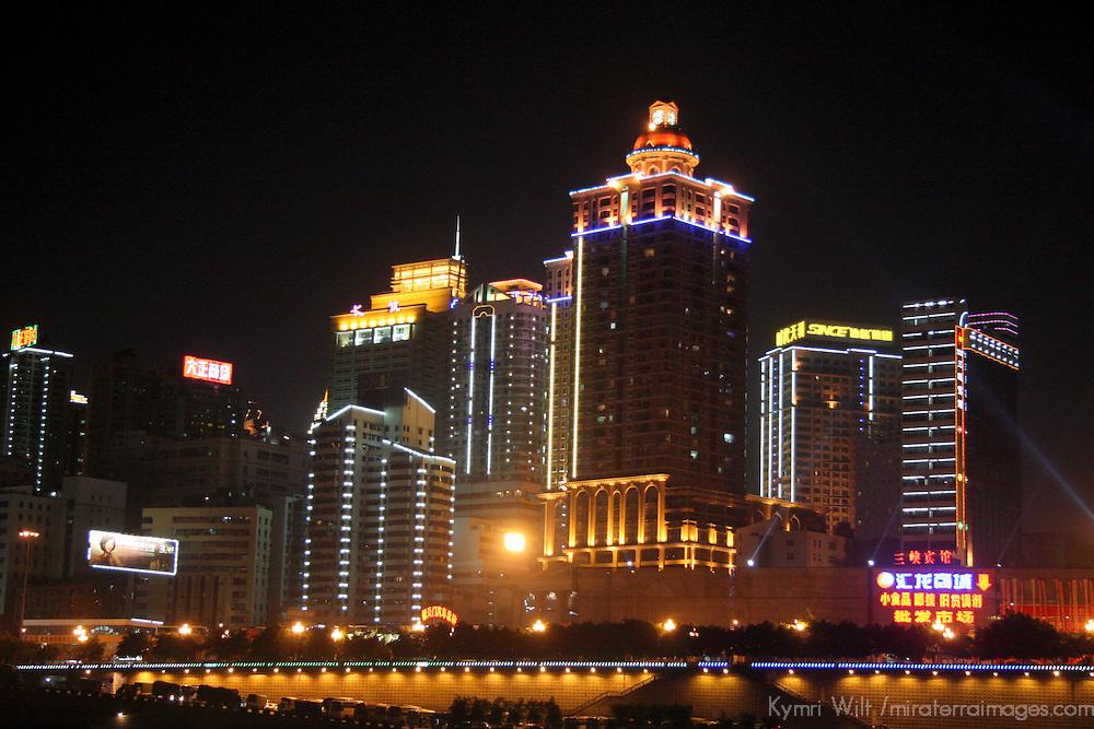 Asia, China, Chongqing.  The city of Chongqing lights up at night as cruises deaprt on the Yangtze River.