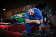 Volunteer restoring Steam Locomotive at Richmond Vale Rail Museum, Hunter Valley, NSW, Australia