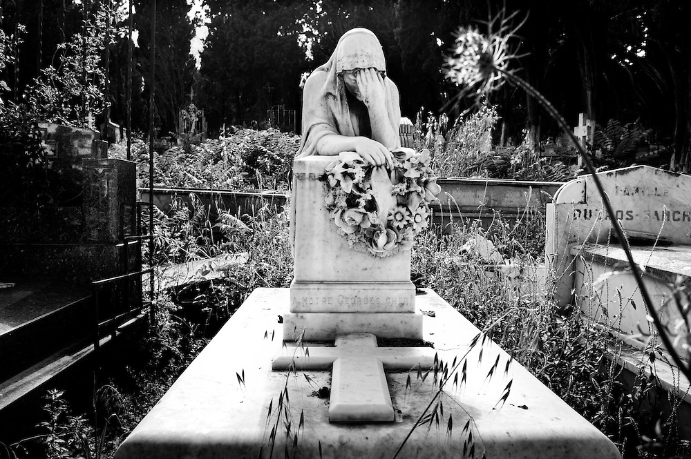 Algiers May 2012. A statue in the catholic cemetery of Algiers located in Bologhine, Saint Eugene  neighborhood. In the cemetery are buried all the european pieds noirs (italians, french, spanish) and the militaries who died during the Independence war.