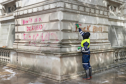 © Licensed to London News Pictures. 07/06/2020. London, UK. The spray painted words 'Boris is a dickhead' and 'Fuck Boris' are painted with a cleaning solution before being power washed off the walls of The Foreign Office in Whitehall after yesterday's Black Lives Matter protest march . New quarantine rules on passengers entering the United Kingsom come into force tomorrow. People entering the country will have to quarantine for two weeks. Photo credit: Peter Macdiarmid/LNP