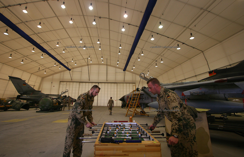 Tornado aircraft mechanics playing foosball while a rest in Camp Marmal, Mazar-e Sharif.