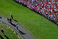Oct 2, 2016; Chaska, MN, USA; (Editor note: a tilt-shift lens was use to create this image) Patrick Reed of the United States walks to the first tee during the single matches in 41st Ryder Cup at Hazeltine National Golf Club. Mandatory Credit: Peter Casey-USA TODAY Sports