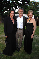 Left to right, Actor PIERCE BROSNAN, his wife KEELEY and JULIA PEYTON-JONES Director of the Serpentine Gallery at the annual Serpentine Gallery Summer Party in association with Swarovski held at the gallery, Kensington Gardens, London on 11th July 2007.<br /><br />NON EXCLUSIVE - WORLD RIGHTS