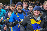 \AFC Wimbledon fans celebrating during the EFL Sky Bet League 1 match between Southend United and AFC Wimbledon at Roots Hall, Southend, England on 16 March 2019.