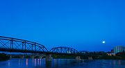 A rare supermoon coinciding with a solstice illuminates the Traffic Bridge on a warm summer evening.