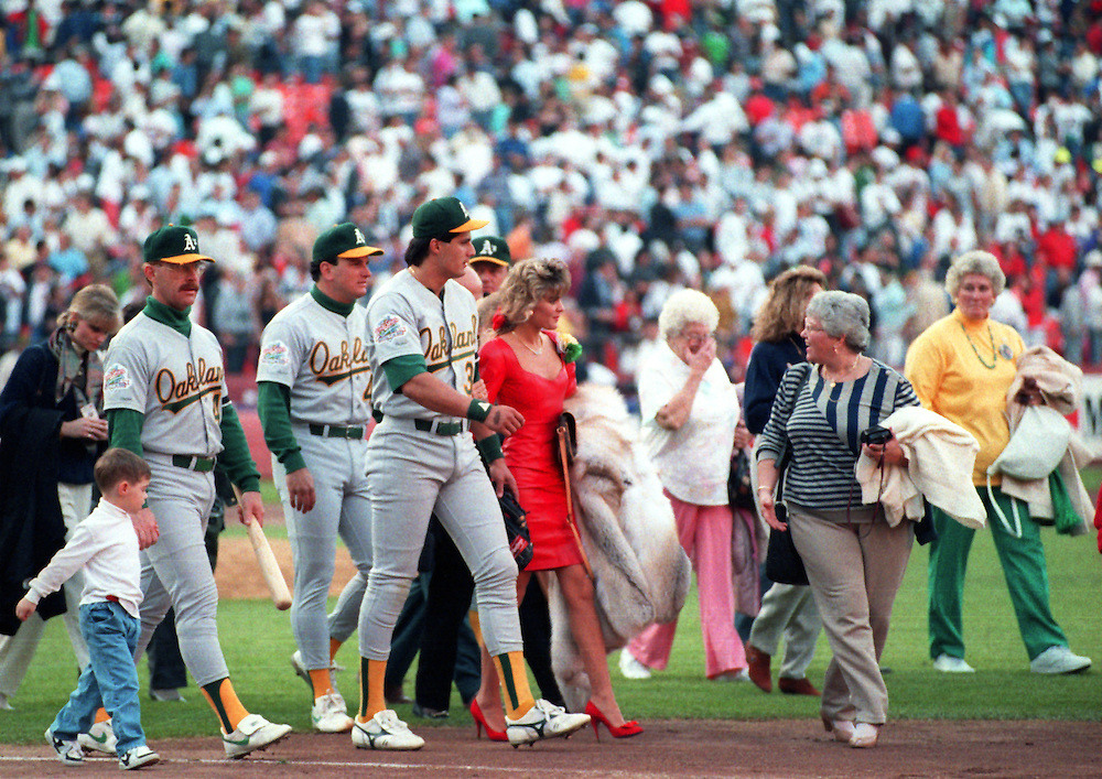 SAN FRANCISCO, CA-OCTOBER 1989: Jose Canseco ot the Oakland Athletics leaves the field with his family after a 6.9 magnitude earthquake cancelled Game 3 of the 1989 World Series between the San Francisco Giants and Oakland Athletics at Candlestick Park in San Francisco, California.  (Photo by Ron Vesely)