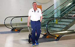 England's head coach Trevor Bayliss as the team arrive at Adelaide Airport.
