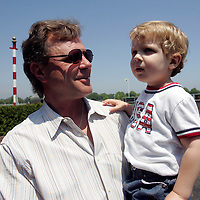 (PPAGE1) Monmouth Park 5/13/2006 Kevin G. Sleeter holds his 3 year old son Justin.   Kevin trained the horse that won the first race of the season.   Michael J. Treola Staff Photographer.....MJT