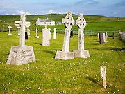 Gravestones in burial ground on Vatersay Island, Barra, Outer Hebrides, Scotland, UK - two headstones leaning towards each other
